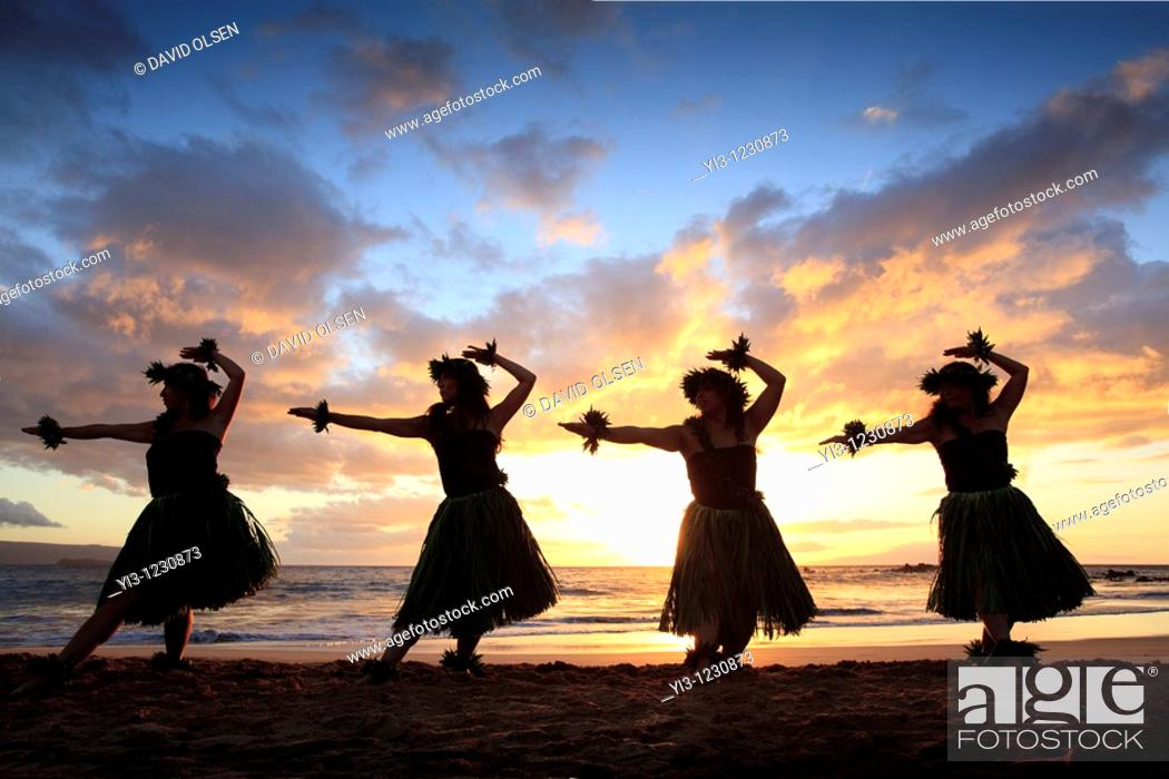 Stock Photo: Silhouette of hula dancers at sunset at Palauea Beach, Maui, Hawaii.