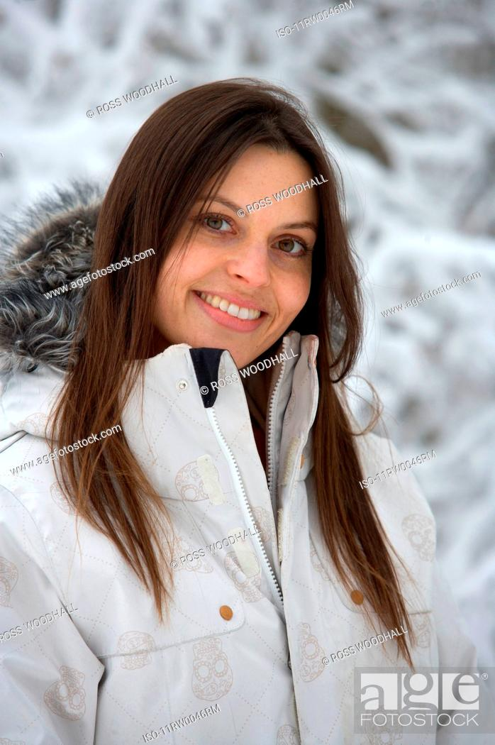 Stock Photo: Female by snow covered trees.