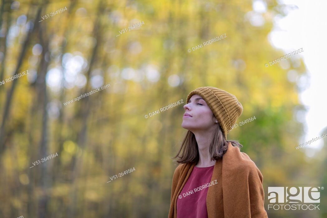 Stock Photo: Brunette Woman in Park in Autumnn.