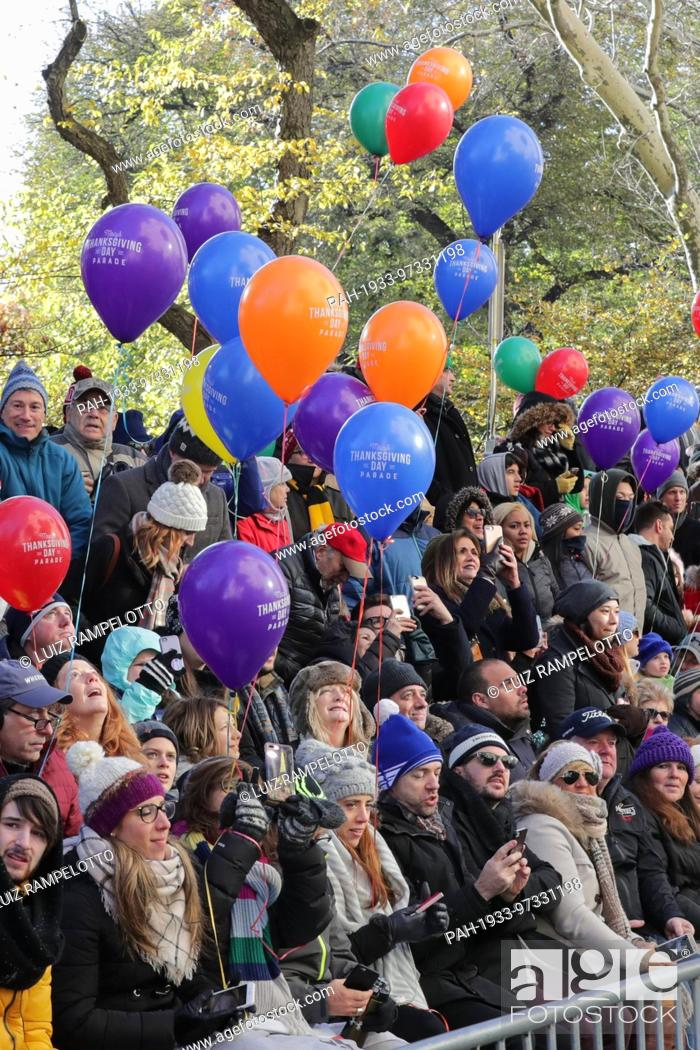 Stock Photo: Central Park West, New York, USA, November 23 2017 - Thousands of Parade Goers attends the 91st Annual Macy's Thanksgiving Day Parade today in New York City.