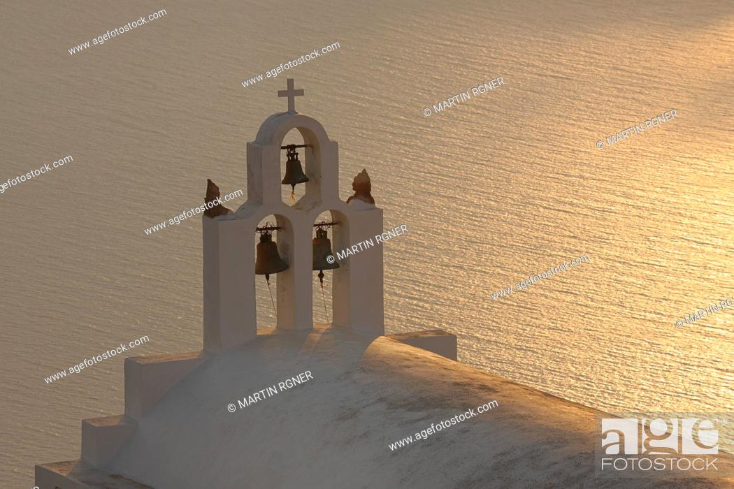 Stock Photo: Greece, Bell Tower of whitewashed church and sea in background Imerovigli at Santorini.