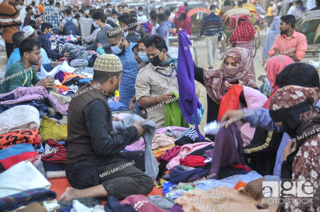 Stock Photo: Customers are busy buying winter clothes at street shops in Sylhet, Bangladesh.