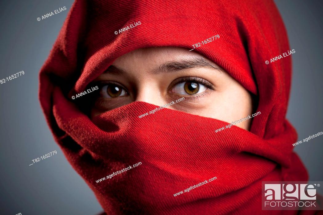 Stock Photo: Woman with a red veil.