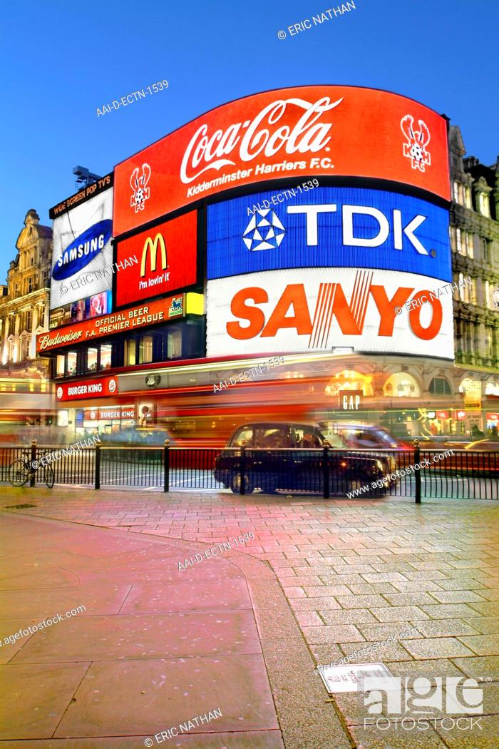 Piccadilly Circus in London with its neon/digital signs in the early