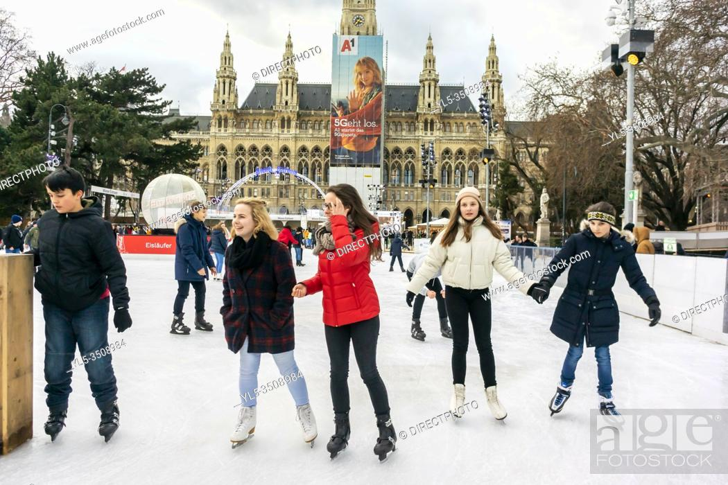 Imagen: Vienna, Austria, Austrian Teenagers Ice Skating in Front of City Hall Building, Rathaus, .