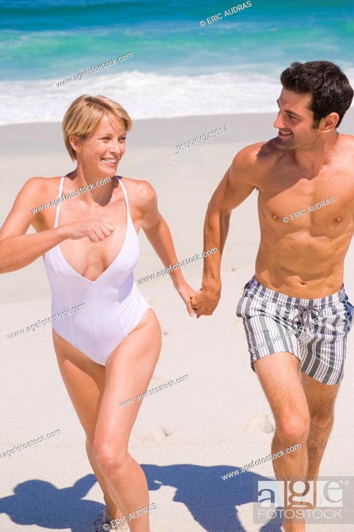 Stock Photo: Couple running on the beach.