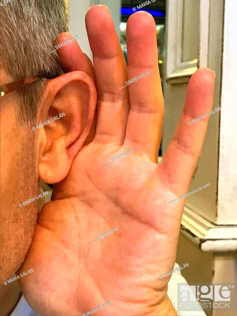 Stock Photo: Deaf man trying to hear.