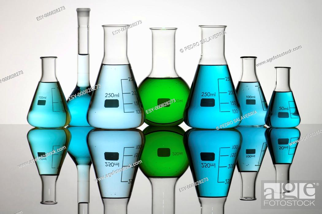 Stock Photo: group of laboratory flasks containing liquid color.