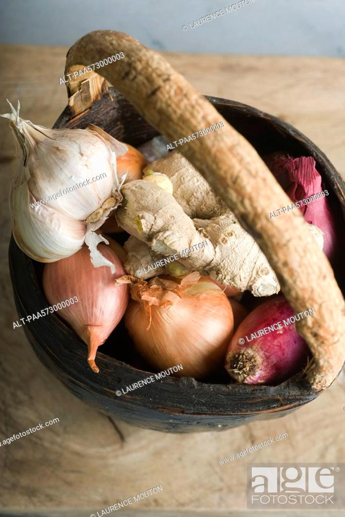 Stock Photo: Onion, garlic, and ginger root in basket.