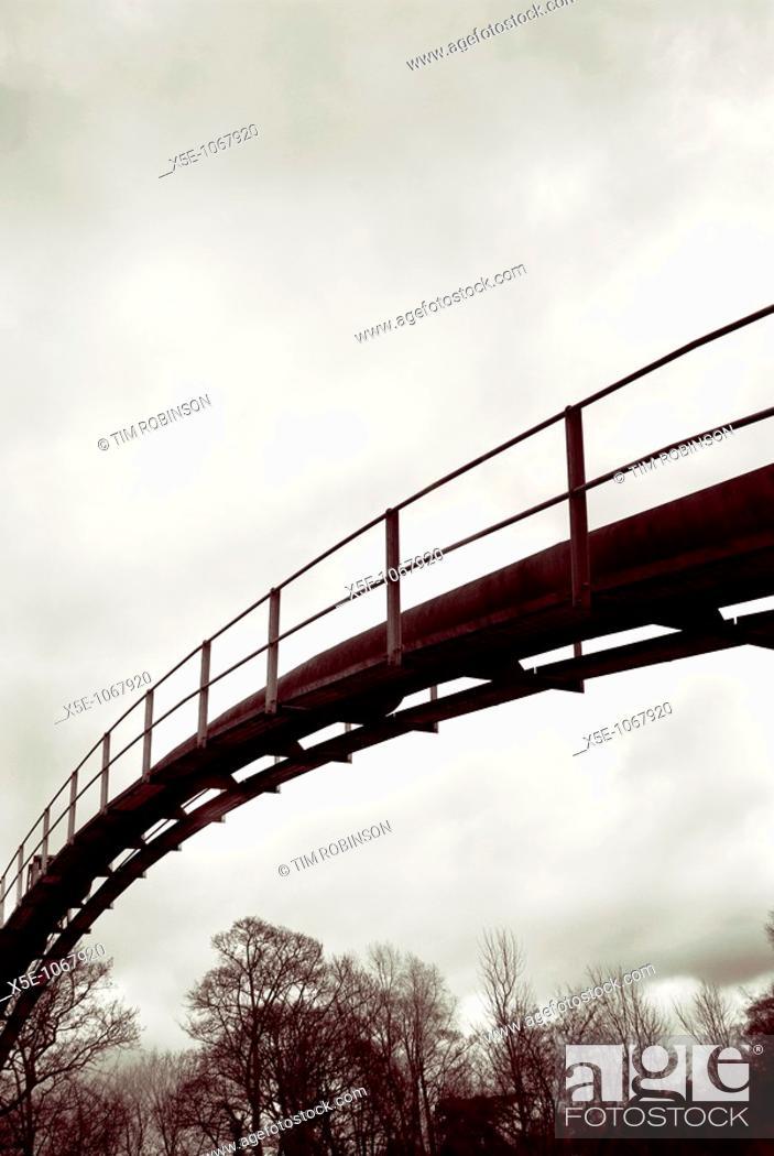 Stock Photo: Footbridge over river.