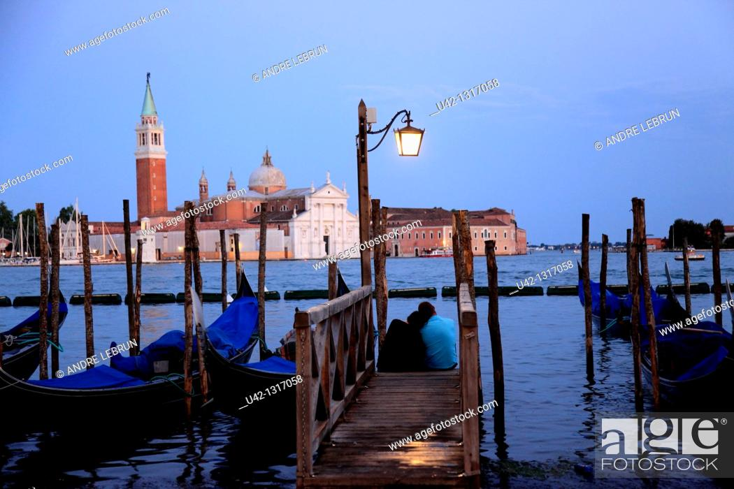 Stock Photo: Gondolas moored by the Grand Canal in Venice with Chiesa di San Giorgio Maggiore in the background, Veneto, Italy.