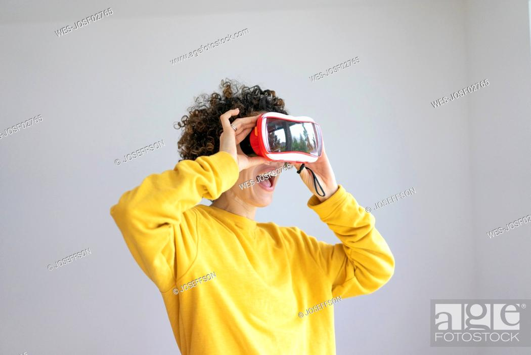 Stock Photo: Excited woman wearing VR glasses.