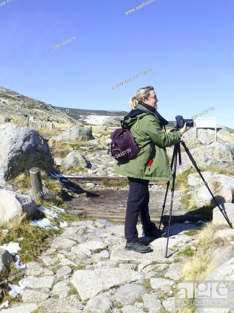 Stock Photo: Woman photographer photographing mountains in Gredos, Spain.