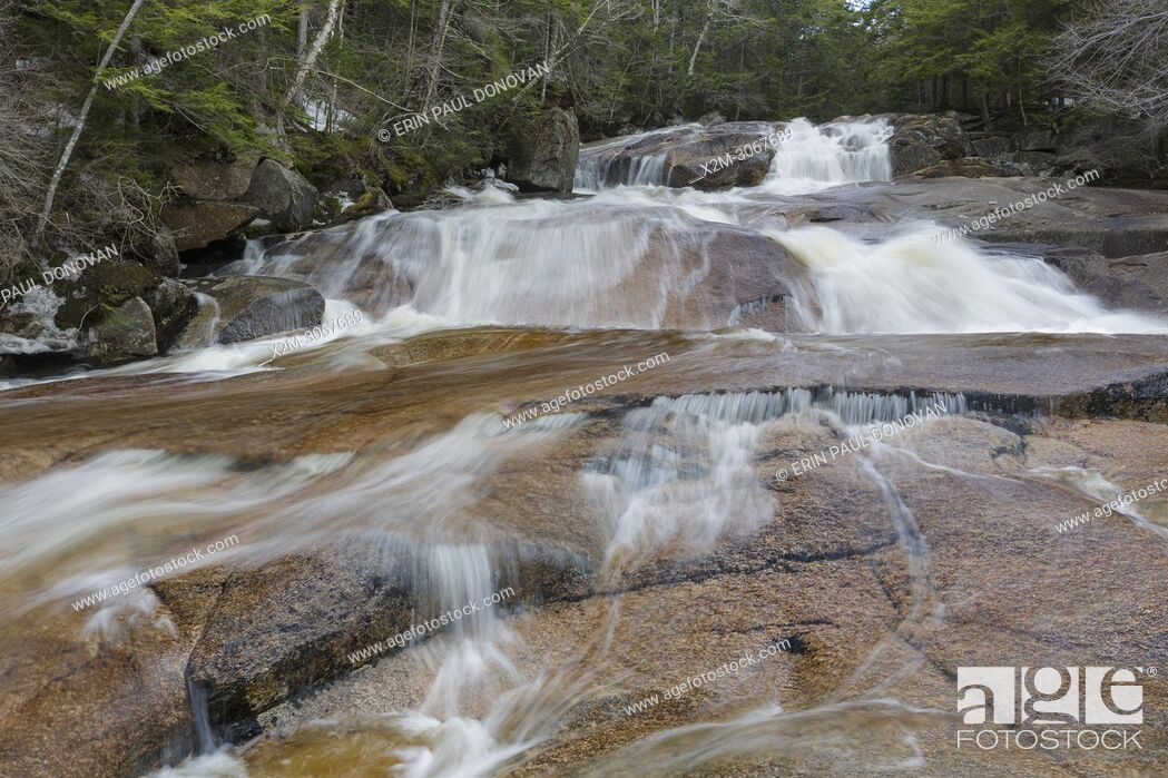 Stock Photo: One of the many cascades on Cascade Brook in Lincoln, New Hampshire on a spring day. This brook is located along the Basin-Cascades Trail.