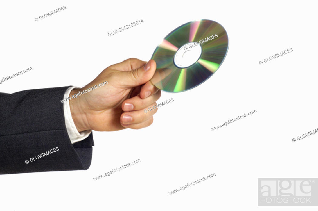 Stock Photo: Close-up of a businessman holding a compact disk.
