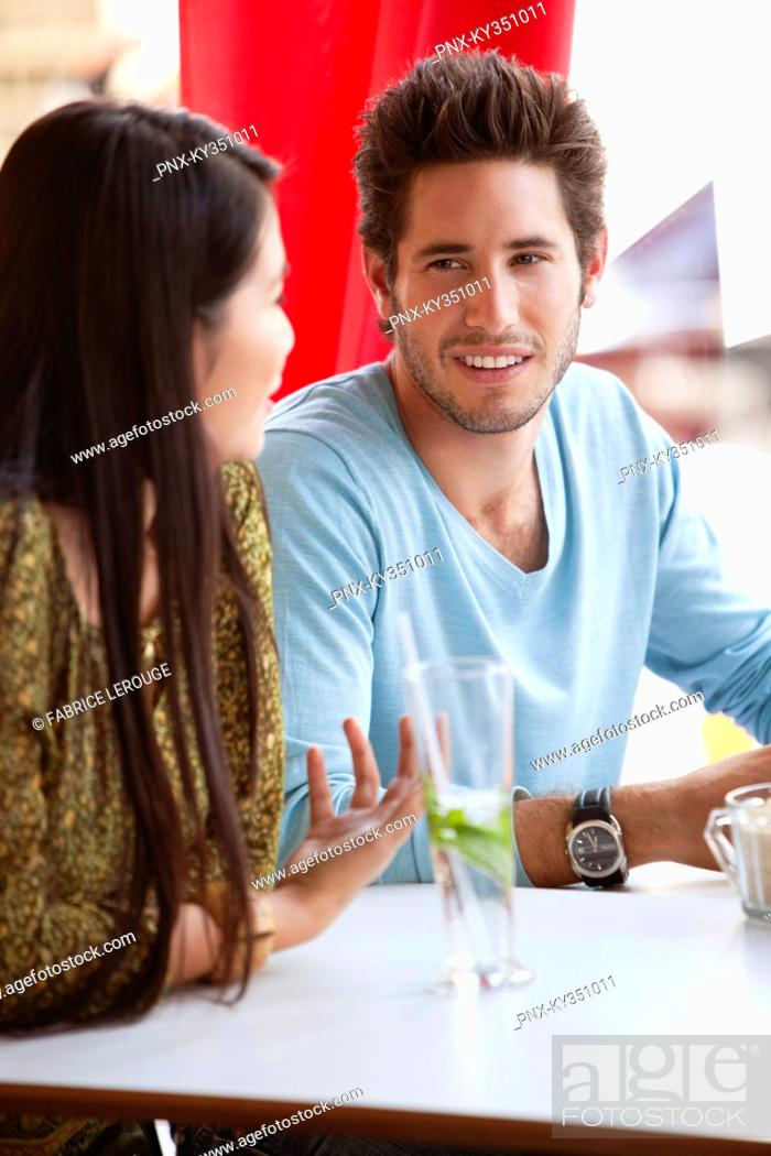 Stock Photo: Couple having discussion in a restaurant.