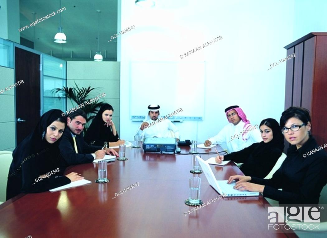 Stock Photo: Meeting of Arab businesspeople in the boardroom.