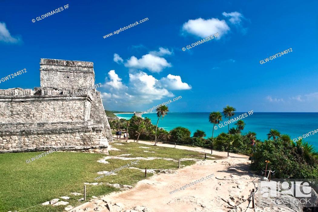 Stock Photo: Ruins of a castle at the seaside, Zona Arqueologica De Tulum, Cancun, Quintana Roo, Mexico.