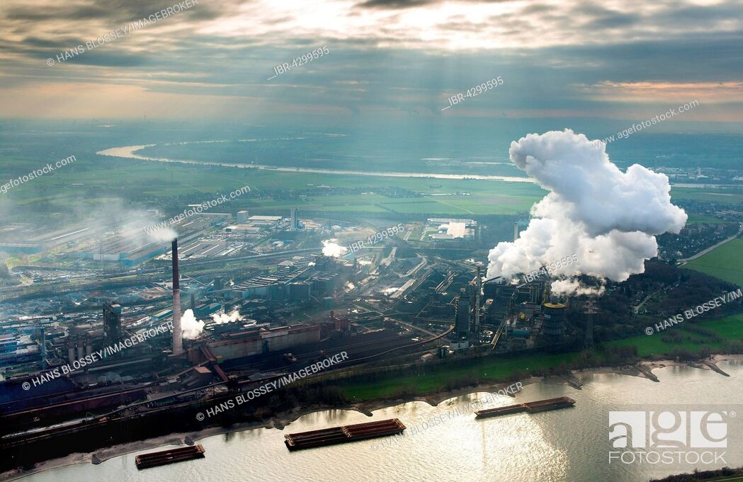 Stock Photo: Steelworks HKM am Rhein, steelworks Krupp-Mannesmann, smoking chimneys, coking plant, industry, Duisburg, Ruhr district, North Rhine-Westphalia, Germany.