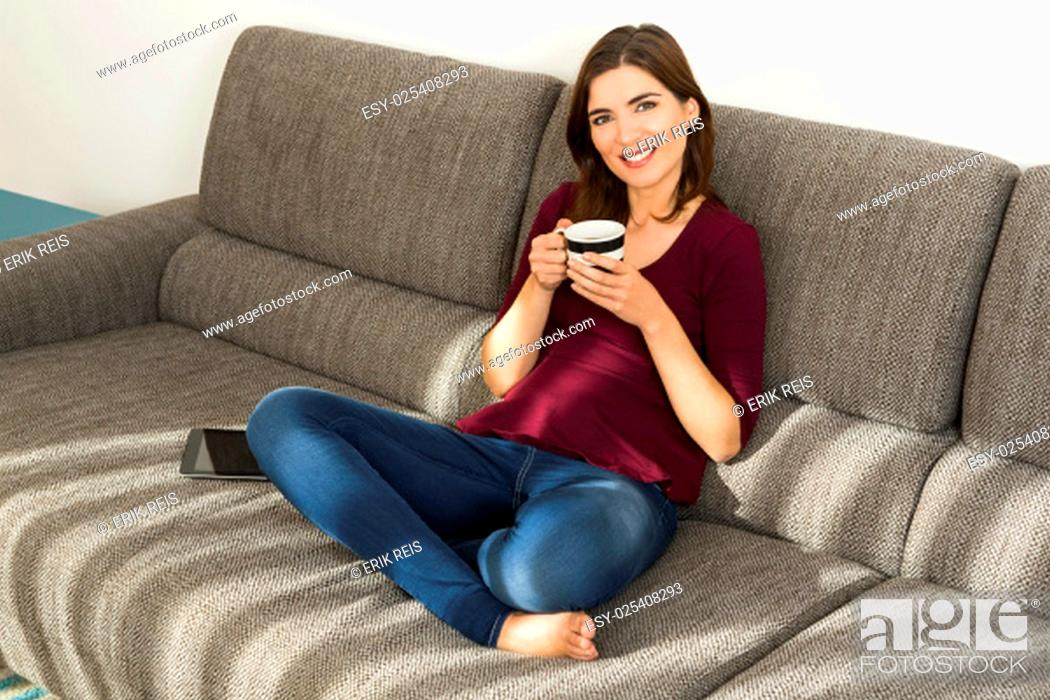 Stock Photo: Beautiful woman at home drinking a cup pf tea.