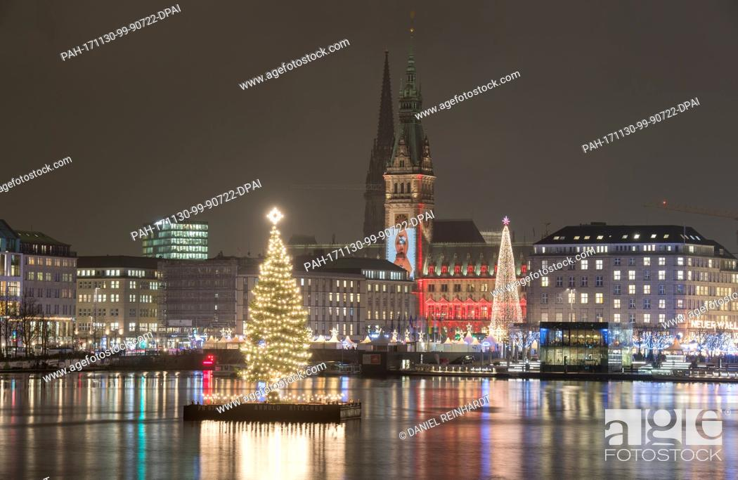 Stock Photo: The Christmas tree in the middle of the Binnenalster river, also called 'Alstertanne', is illuminated in Hamburg, Germany, 30 November 2017.