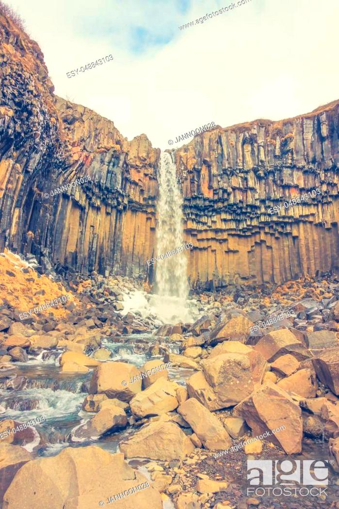 Stock Photo: Beautiful famous waterfall in Iceland, winter season ( Filtered image processed vintage effect. ).