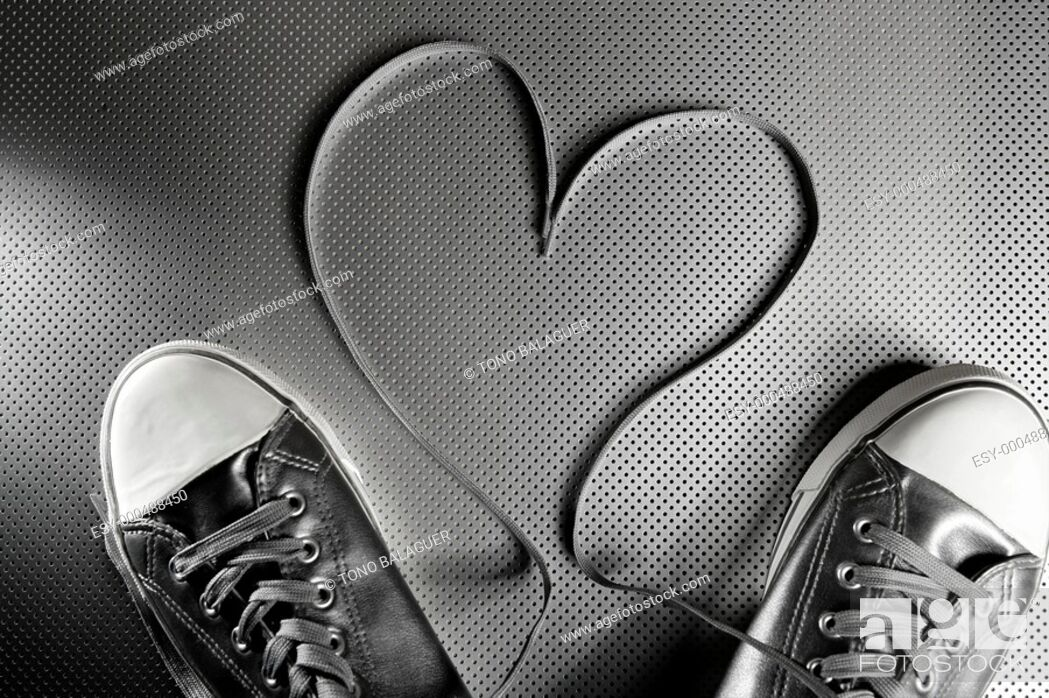 Stock Photo: Laces of silver shoes, threads with heart valentines shape.