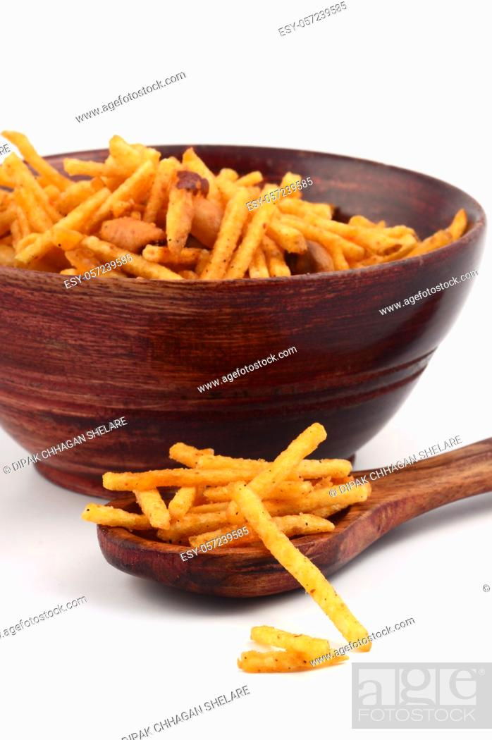 Stock Photo: Deep fried salty dish - chivda or mixture made of gram flour and mixed with dry fruits.
