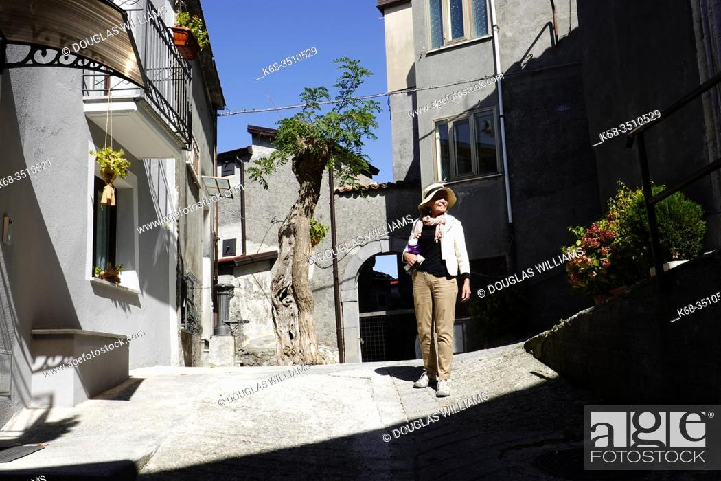 Stock Photo: Woman, 69, in a street of Mormanno, Calabria, Italy.