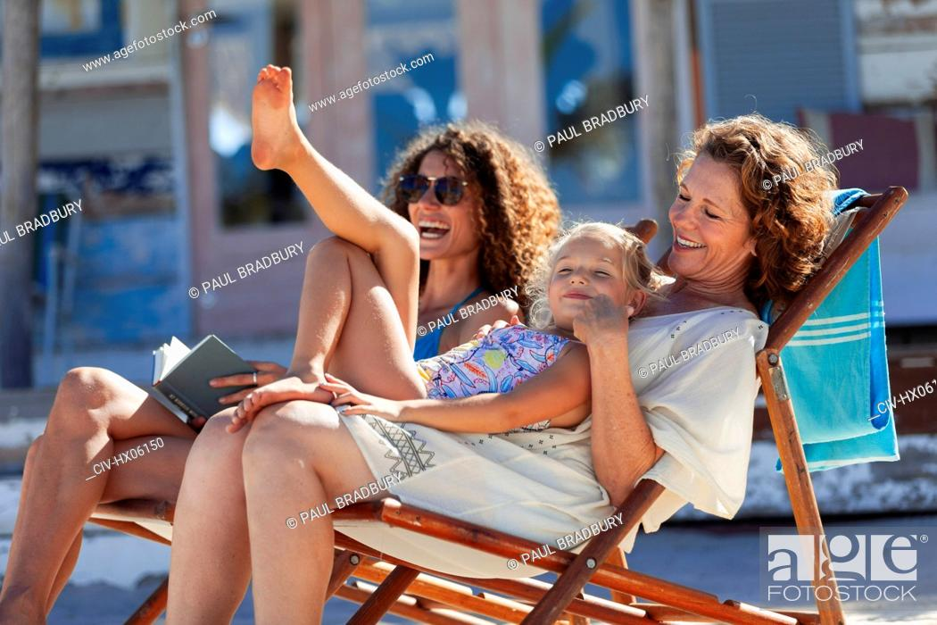 Stock Photo: Playful, happy multi-generation women relaxing on sunny beach.
