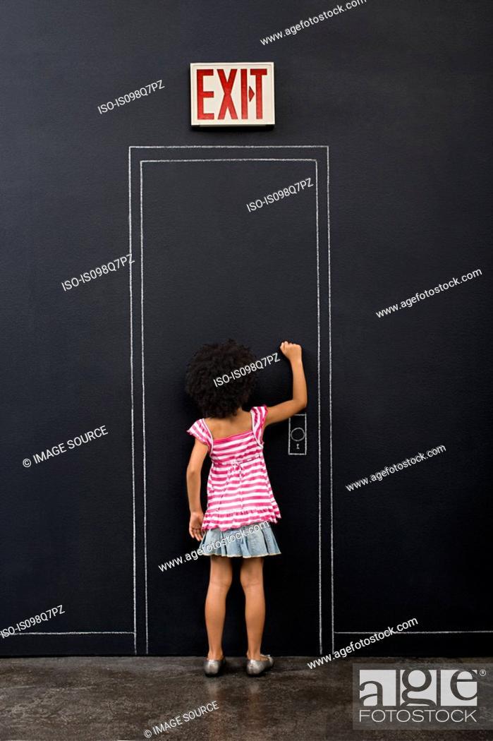 Stock Photo: Girl knocking door.