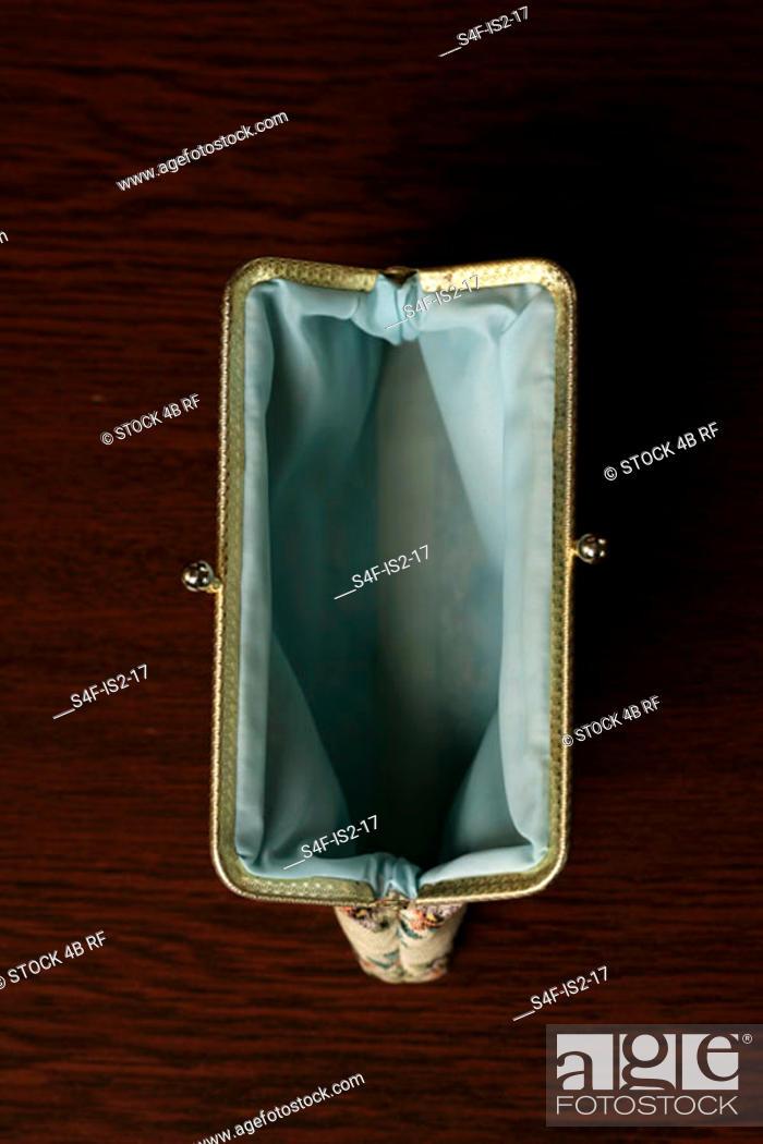 Stock Photo: Empty purse, high angle view.