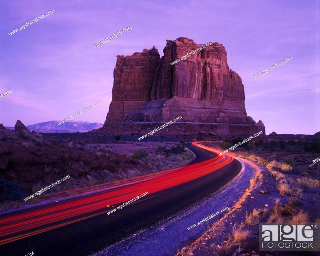 Stock Photo: Road, Organ Butte, Courthouse Rocks, Arches National Park, Utah, USA.