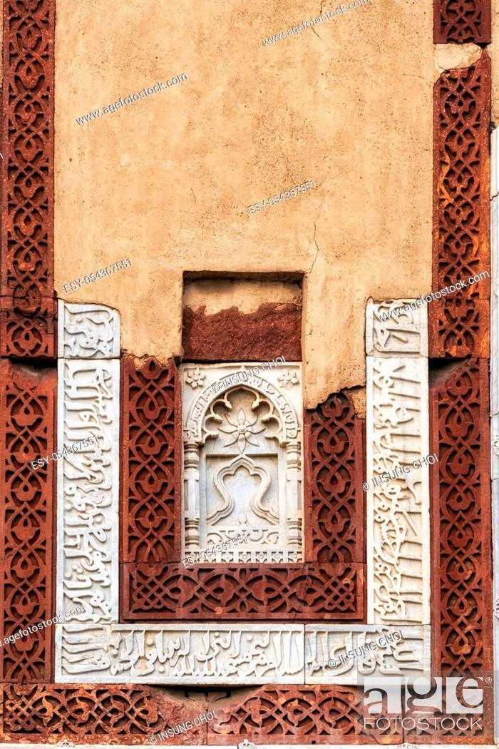Stock Photo: alai darwaza window patterns and exterior details in qutub minar complex in new delhi, india.
