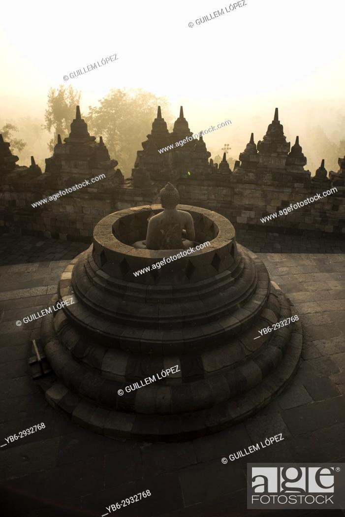 Stock Photo: Buddha statue at the Borobudor temple in Java, Indonesia.