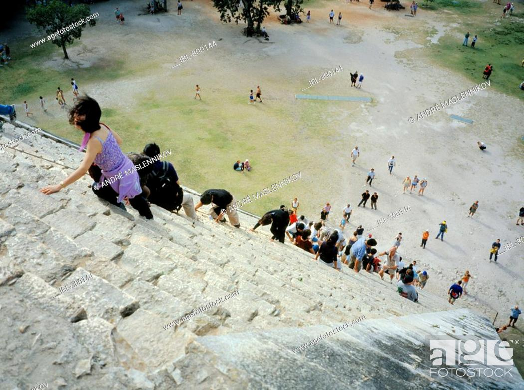 Stock Photo: Tourists are climbing up the stairs to the pyramid. El Castillo, Yucatán, Mexico.