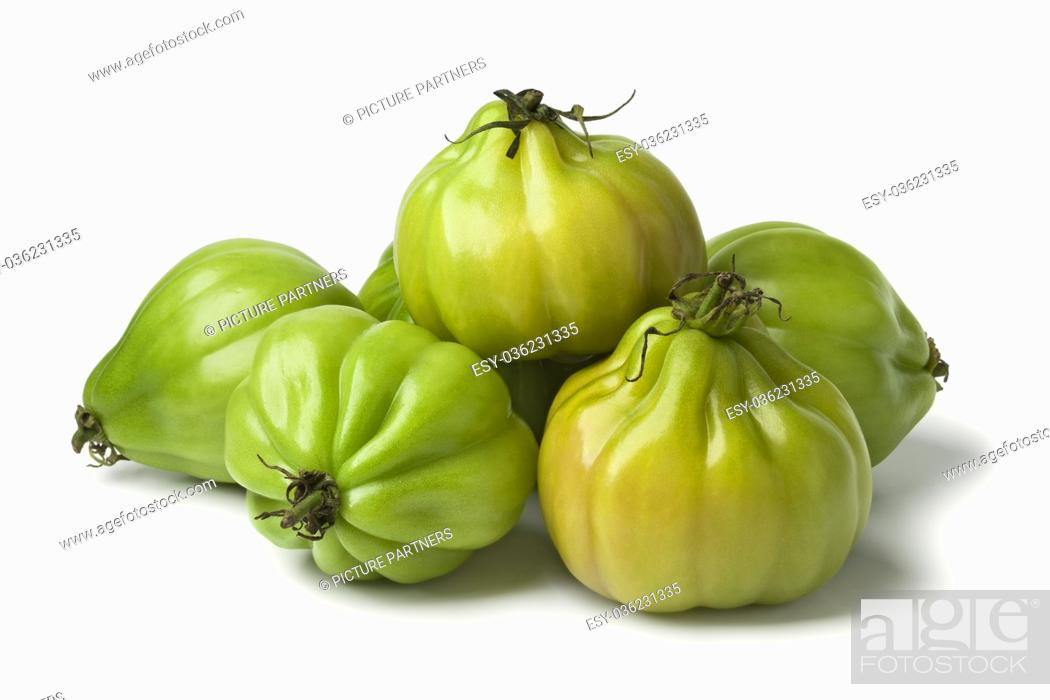 Stock Photo: Heap of green Coeur de boeuf tomatoes on white background.