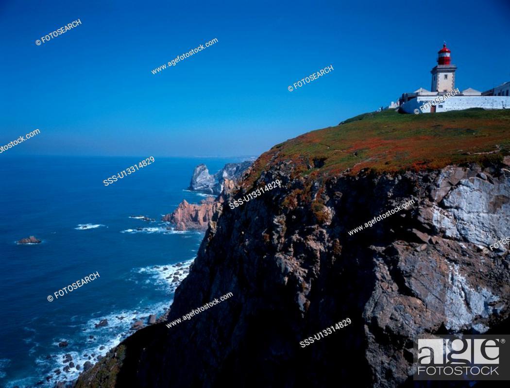 Stock Photo: Lighthouse On Rocks.