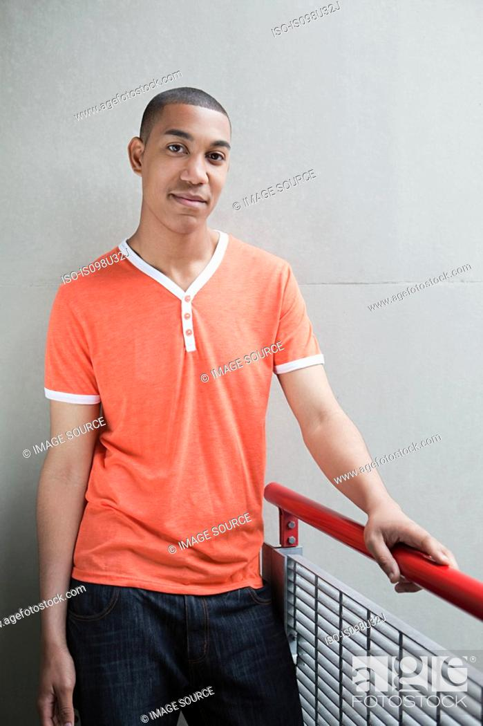 Stock Photo: Young man by railing.