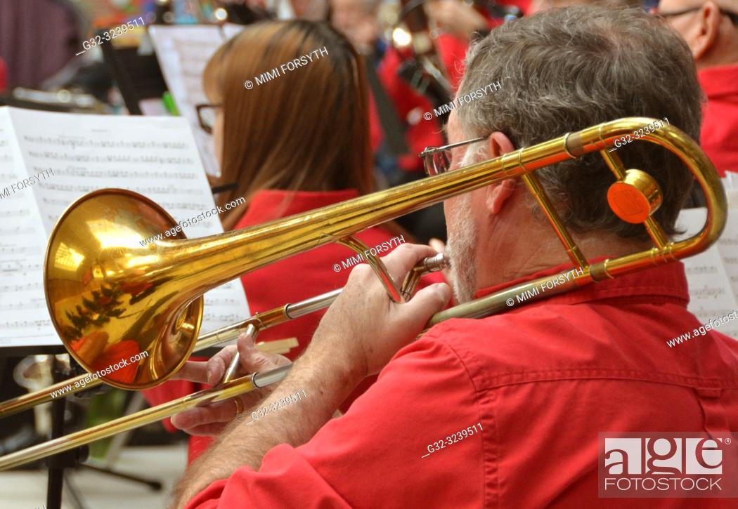 Stock Photo: trombonist, amateur orchestra in performance, New Mexico.