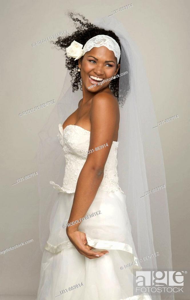Stock Photo: Black Latin Bride in her 20s smiles happily.
