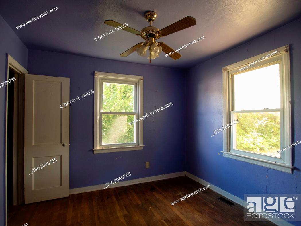 Stock Photo Interior Of A Room With Ceiling Fan Closed Windows And Hardwood Floor In Foreclosed Home Richmond Virginia United States
