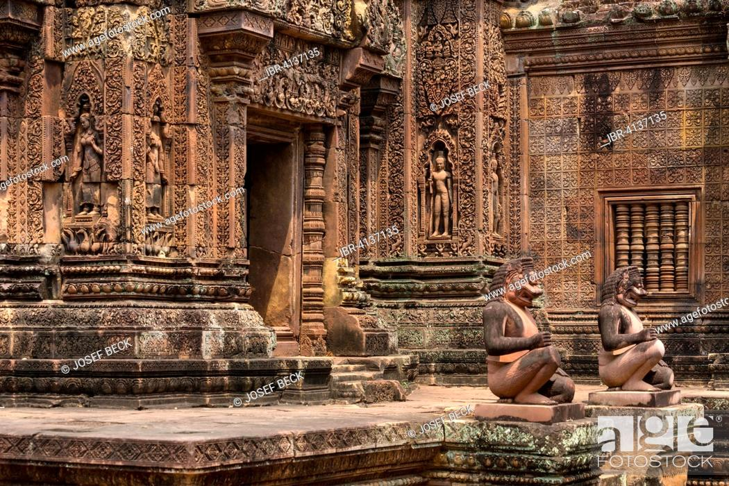 Stock Photo: Guardian figures in front of Mandapa and the southern Prasat, Khmer Hindu temple Banteay Srei, Angkor region, Siem Reap Province, Cambodia.