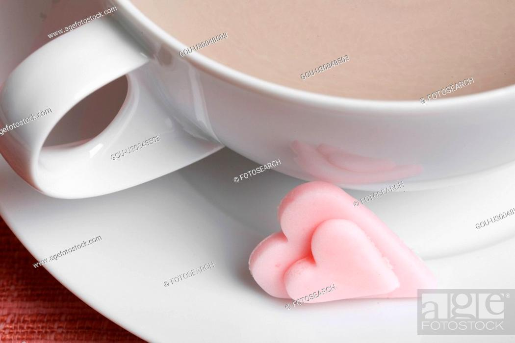 Stock Photo: Heart shaped candies and latte (close-up).
