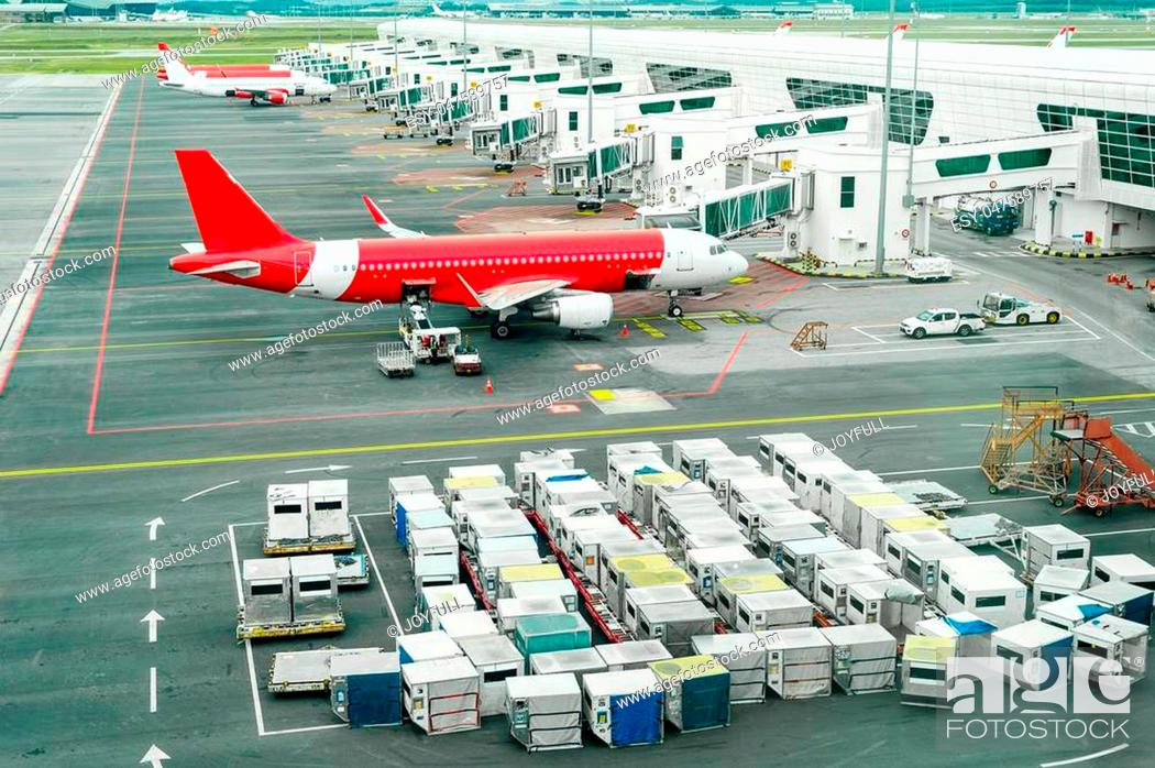 Stock Photo: Airplains and freight containers in airport of Kuala Lumpur, Malaysia.