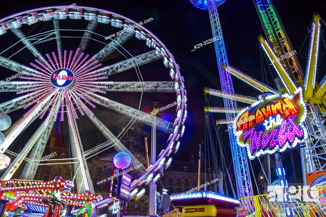 Stock Photo: Dam Square Fun Fair Carnival rides at night, Amsterdam, North Holland, Netherlands.