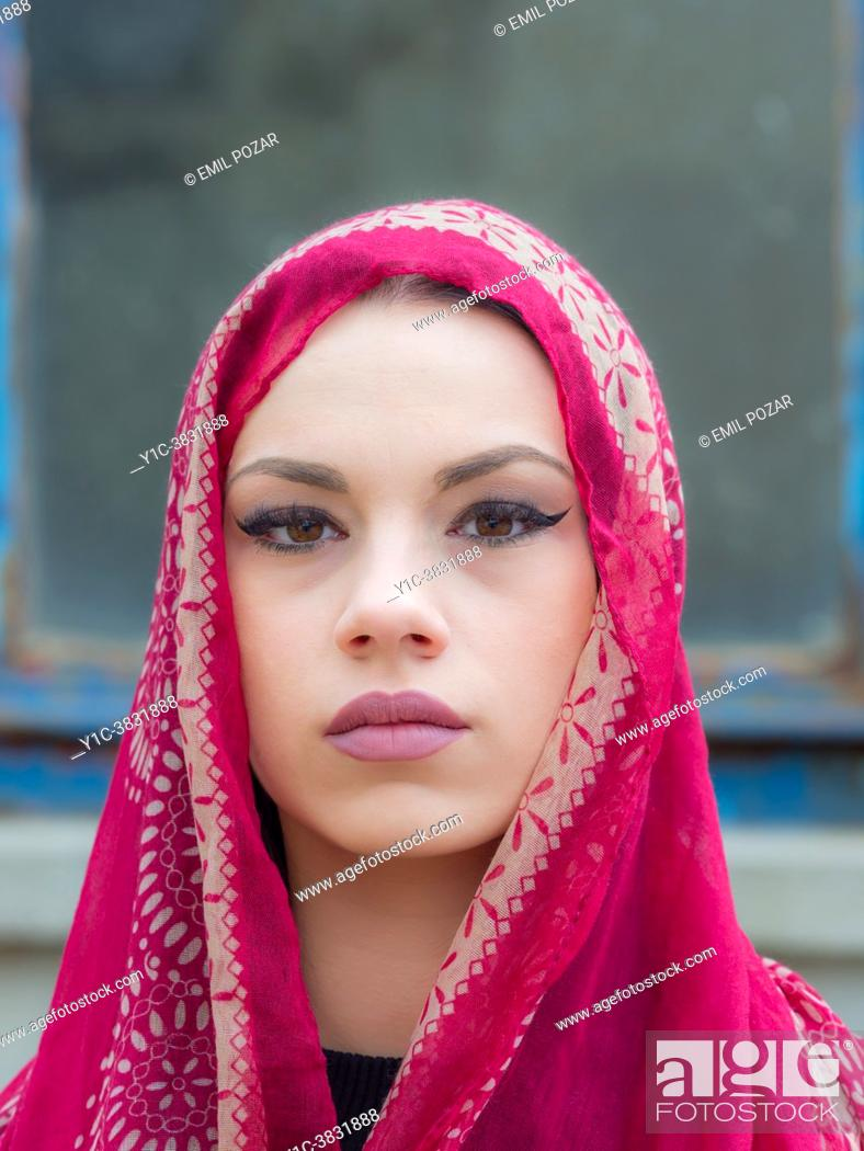 Stock Photo: Sad young adult outdoors portrait under Red scarf.