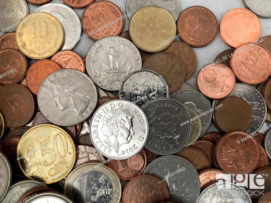 Stock Photo: International coins closeup with british pound in the center representing Brexit.
