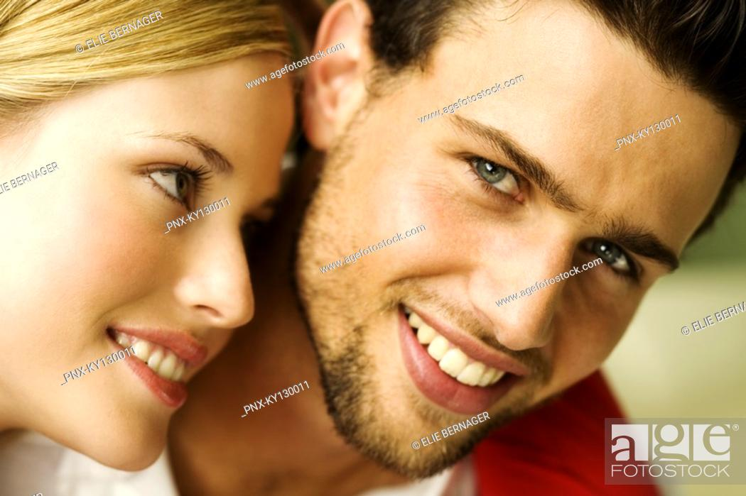 Stock Photo: Portrait of a young smiling couple.