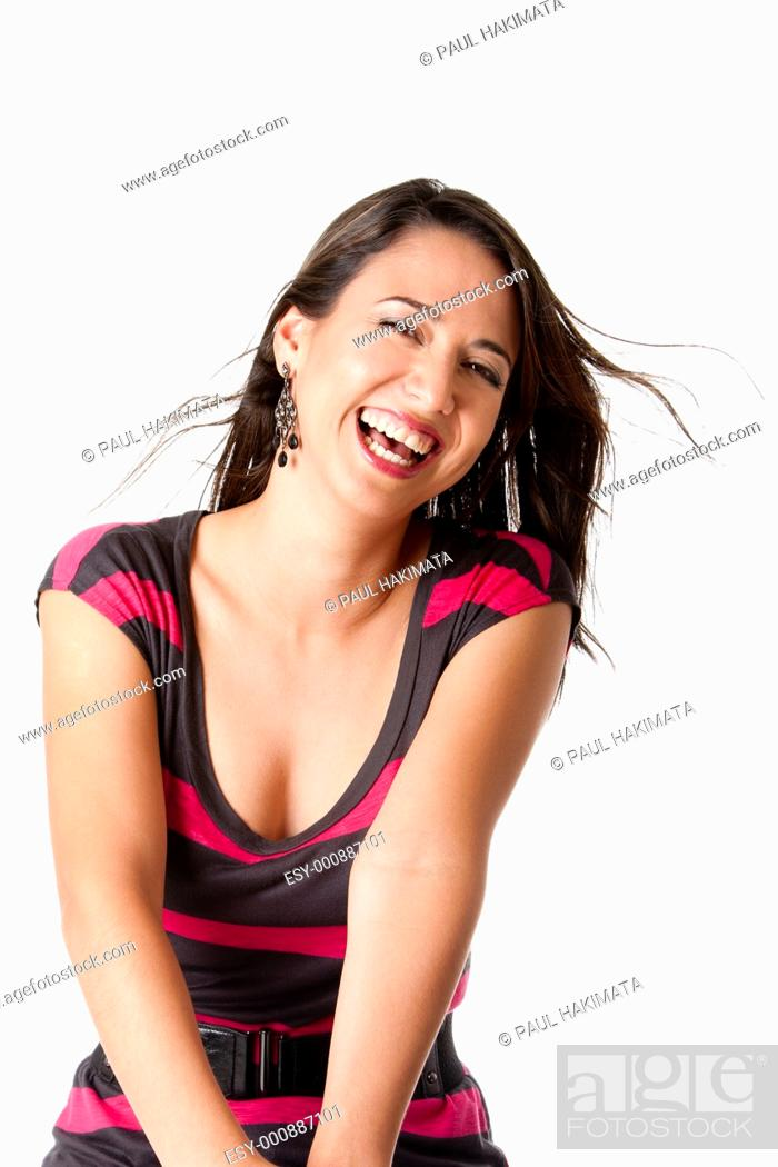 Stock Photo: Beautiful laughing young woman with twirling brown hair having lots of fun, isolated.